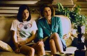 An image from Cruel Intentions of Blair, wearing a koala T-shirt, sat next to Christine Baranski