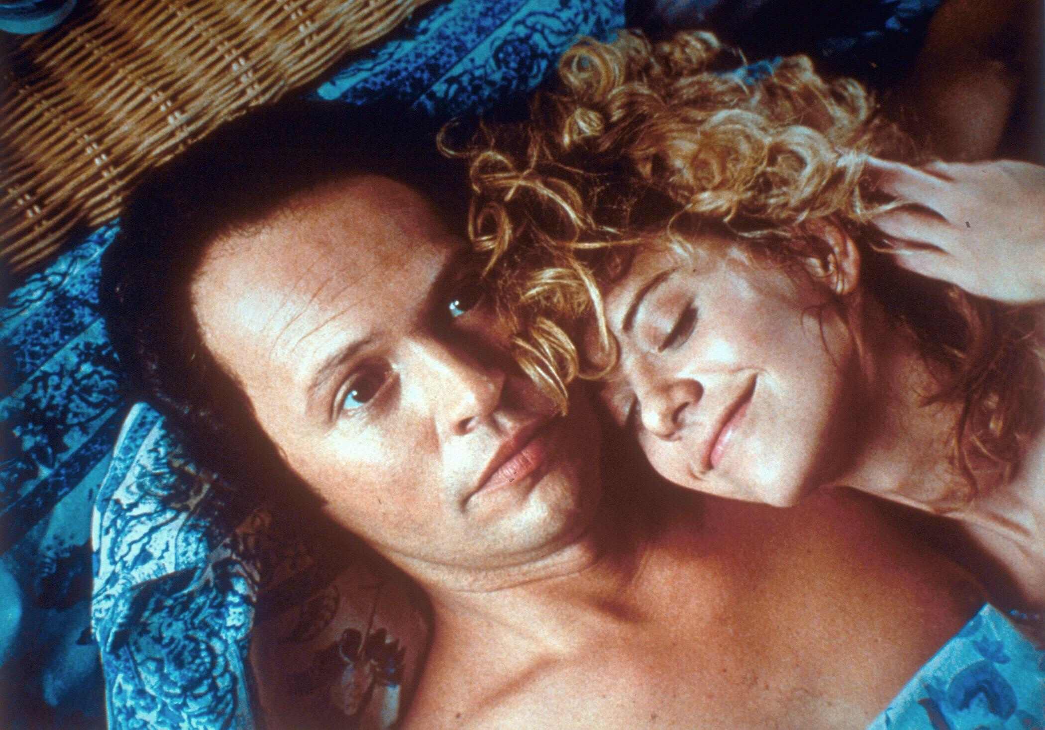 Harry and Sally in bed together. She looks happy, he looks horrified
