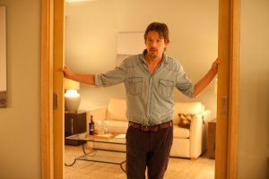 An image from the Before Trilogy of Jesse is standing in a doorway of a hotel room, looking aghast