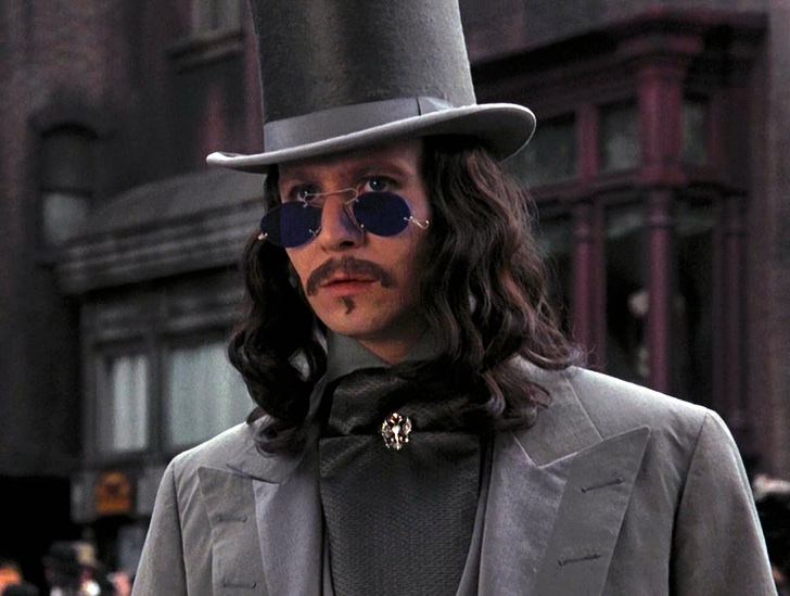 Image from Dracula showing young Dracula dressed as a dandy, wearing a top hat and round purple glasses