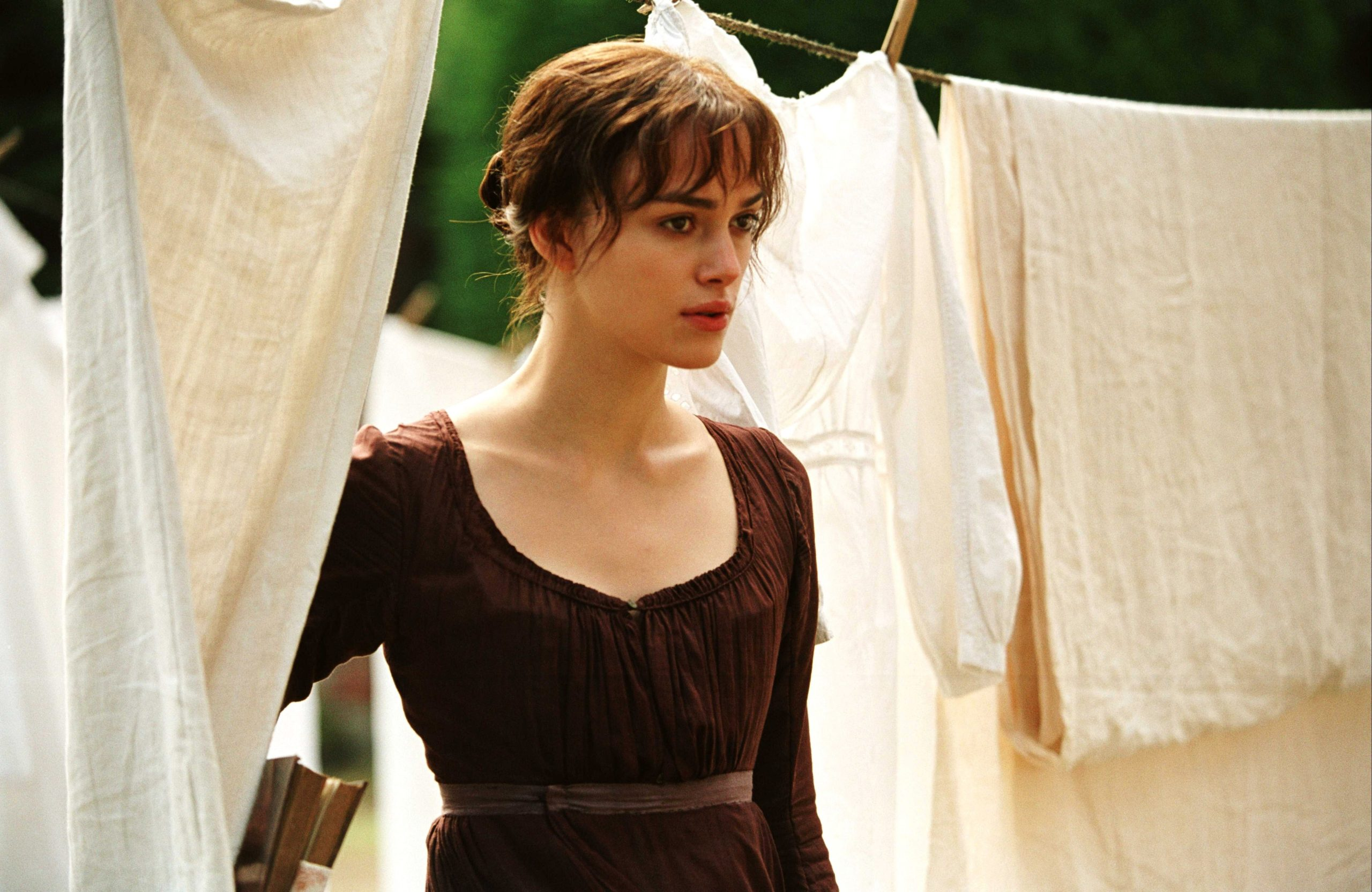 An image from Pride and Prejudice showing Elizabeth standing surrounded by laundry