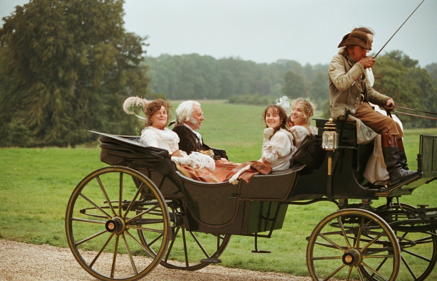 An image from Pride and Prejudice showing the Bennett family in a carriage
