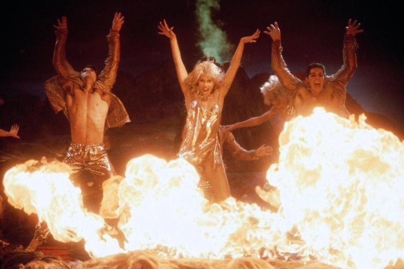 An image from Showgirls showing the dancers surrounded by fire