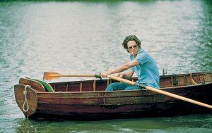 Daniel rowing a boat