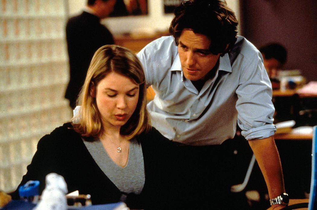 An image from Bridget Jones's Diary of Bridget and Daniel at work