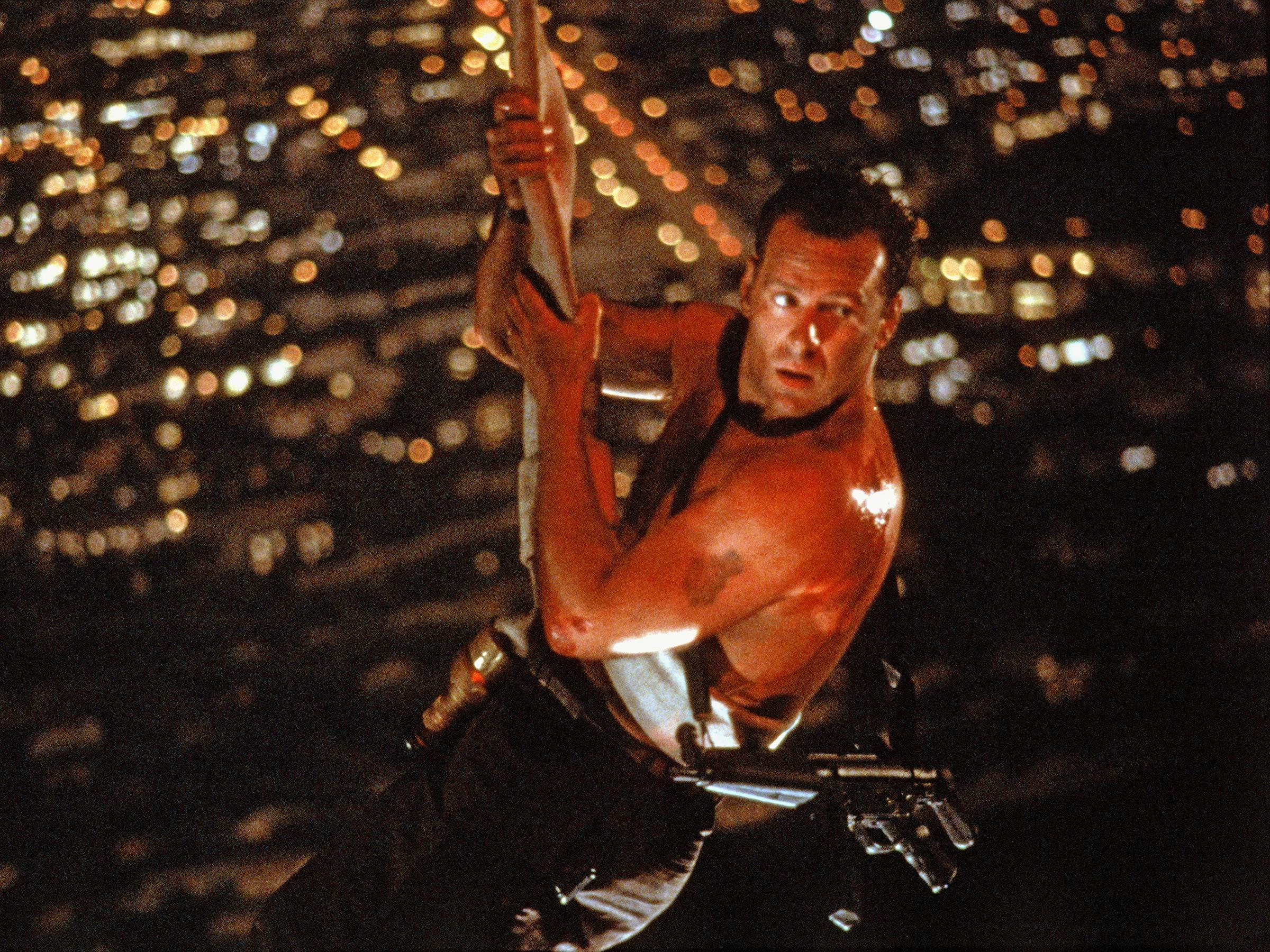 An image from Die Hard showing McClane hanging from the skyscraper