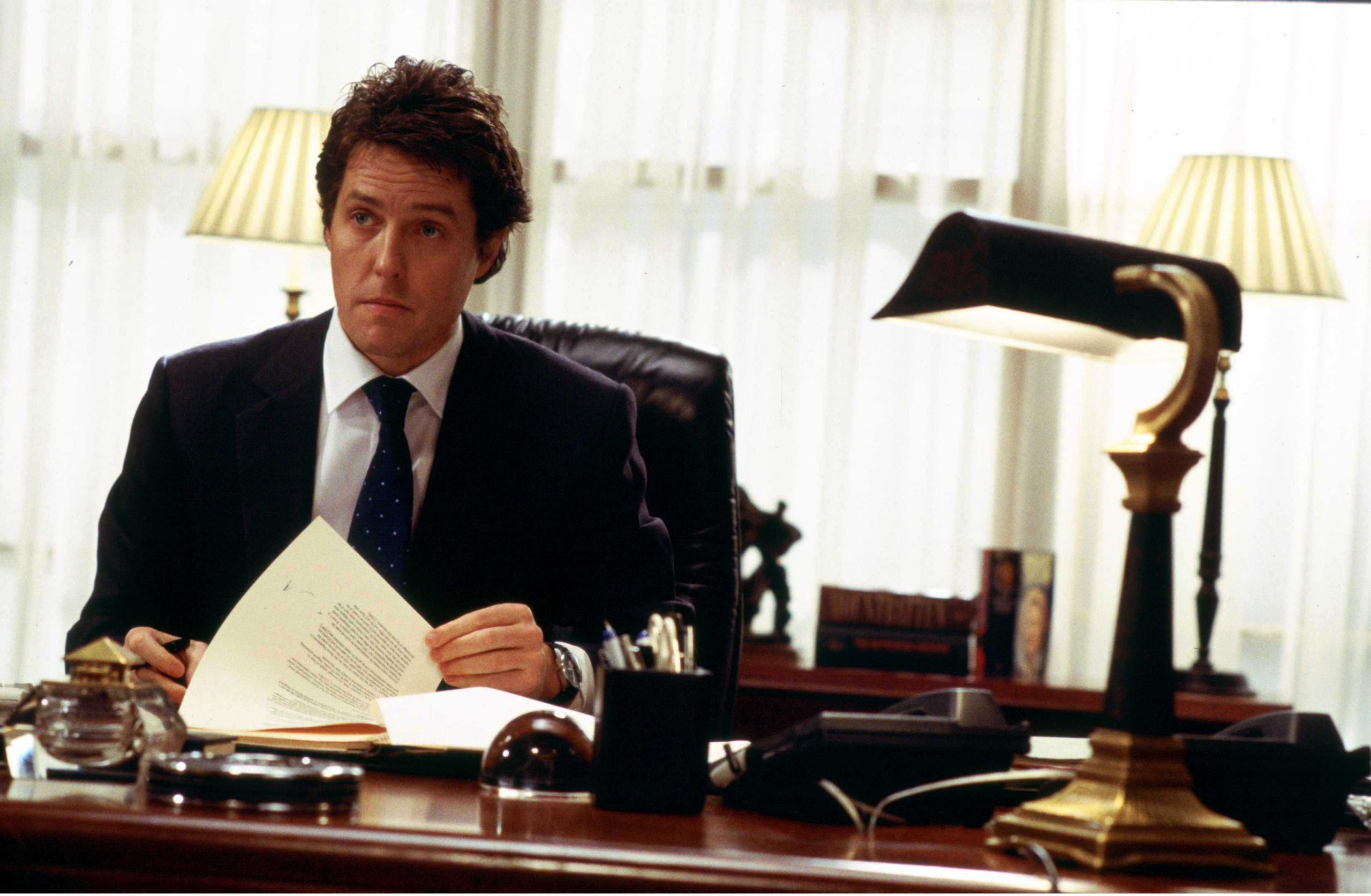An image from Love Actually showing Hugh Grant as prime minister looking baffled