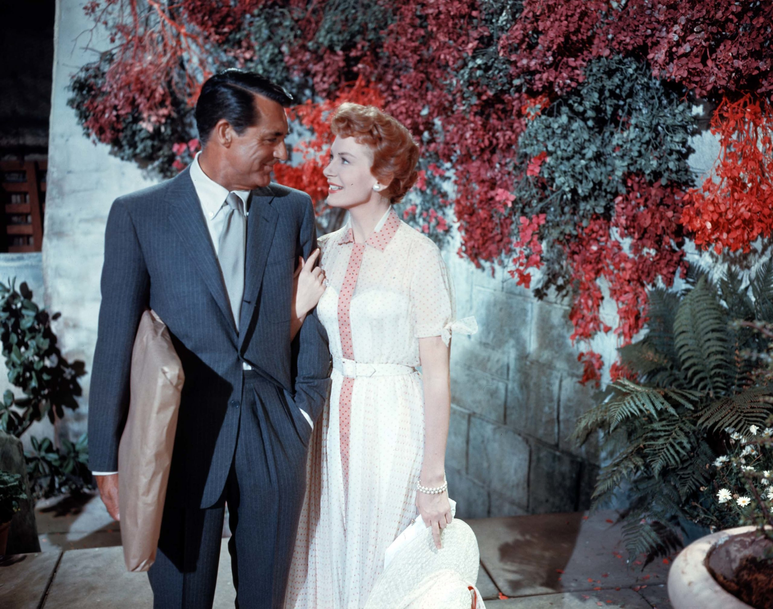 An image from An Affair to Remember showing Nickie and Terry, arm in arm in a garden