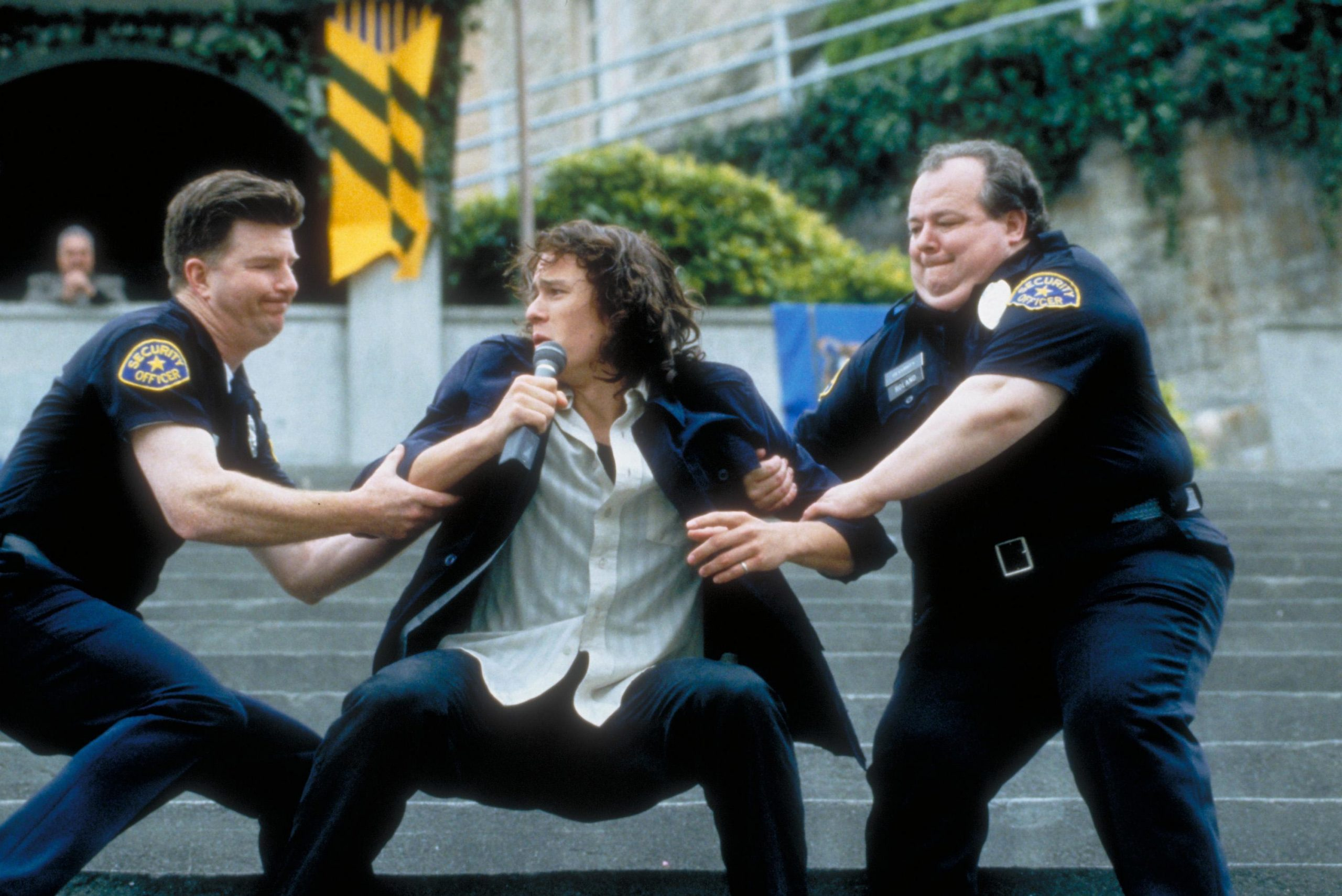 An image from 10 Things of Patrick wrestling campus cops