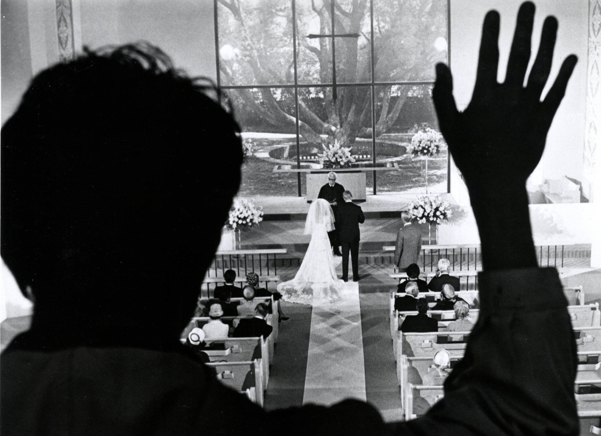 An image from the Graduate of Benjamin looking down at Elaine's wedding
