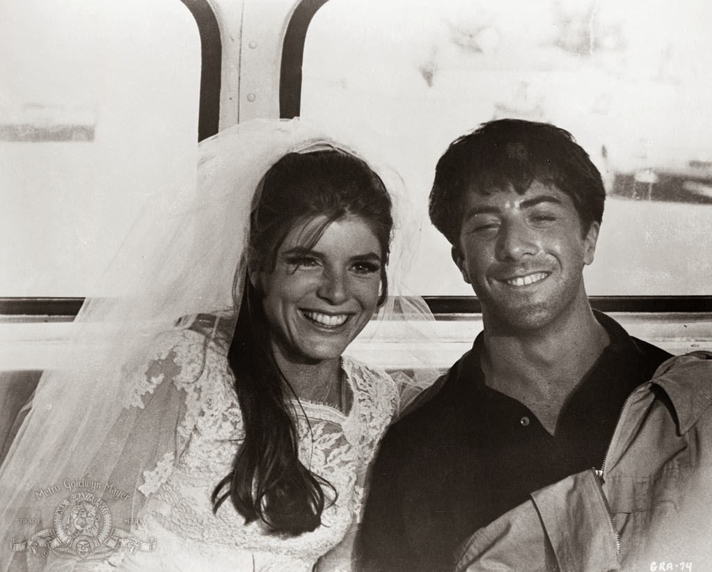 An image from the Graduate of Benjamin and Elaine in the back of a bus, smiling