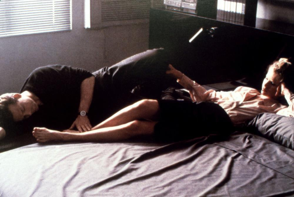 John and Elizabeth lying on a bed