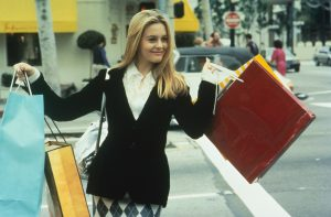 Alicia Silverstone as Cher carrying lots of shopping bags