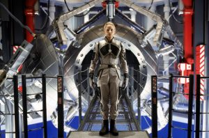 Jodie Foster, dressed as an astronaut, walking into the machine