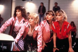 An image from Grease 2 of the girls looking appreciatively at something off screen