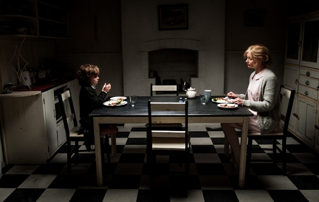 Amelia and Samuel, sitting at a table