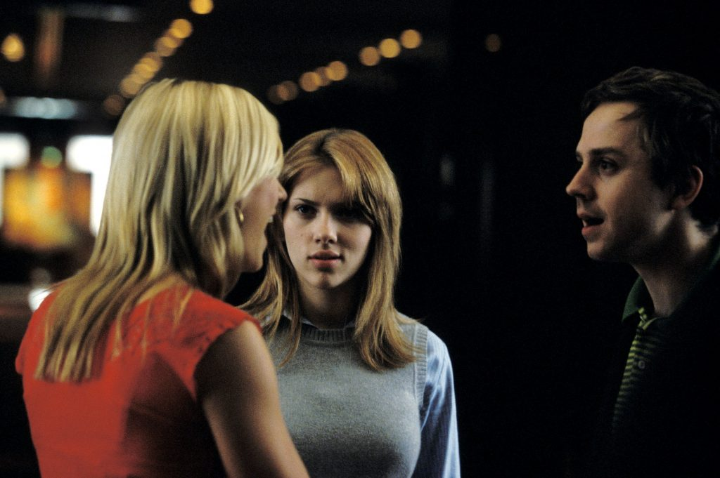 Charlotte and her husband with Kelly. He looks amazed, she looks disgruntled. An image from Lost in Translation